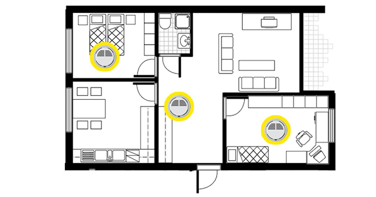 Asunnon pohjapiirros, jossa palovaroittimet on sijoitettu molempiin makuuhuoneisiin ja eteiseen lähelle olohuonetta.